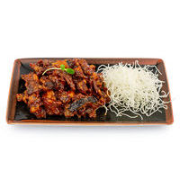 Crispy beef with eggplants in honey-tomato sauce Singapore style