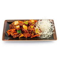 Crispy beef with potatoes in hot sauce