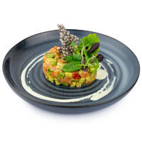 Salmon tartar with oranges, pickled cucumbers and avocado