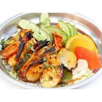 Tandoor cooked piquant tiger prawns with vegetables